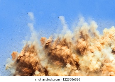 Rock particles in the air after the detonator blast