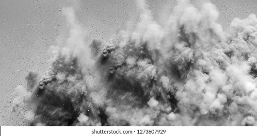 Rock particles in the air after the powerful dynamite blast