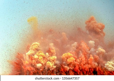 Rock particles and clouds after the dynamite blast on the construction site