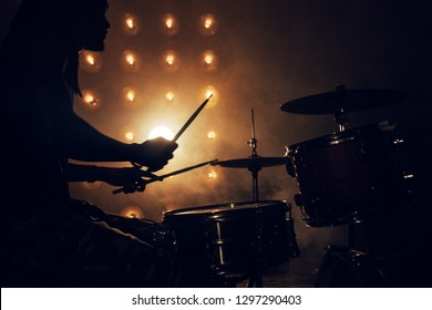rock party at night club. the silhouette of a musician in a dark room