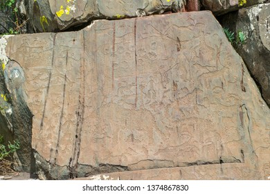 Rock petroglyphs in the tract Kalbak-Tash. Petroglyphs of different historical periods: from the Neolithic to the ancient Turkic era. Altai Mountains, Russia. Russian summer in Siberia.