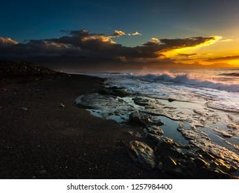 Rock pools on a Caribbean beach at sunrise