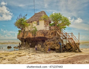 The Rock Restaurant in the ocean by Zanzibar, Tanzania, Afrika.2014, beautiful boulding The rock restaurant on the beach in the ocean isolated on a bright summer day