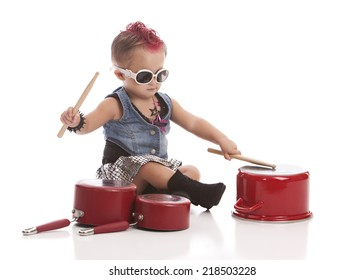 Rock and Roll Baby!  Adorable toddler with a pink mohawk and banging on pots and pans.  Isolated on white with room for your text.