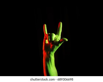 Rock & roll,  heavy metal, sign, horns on a black background, party hard
