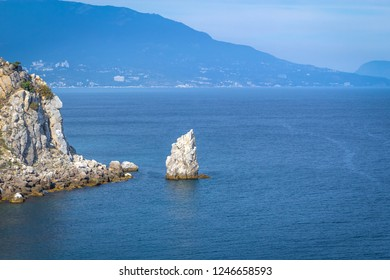 Rock Sail at the Swallow Nest in the Crimea, background with vignette. Beautiful seascape.
