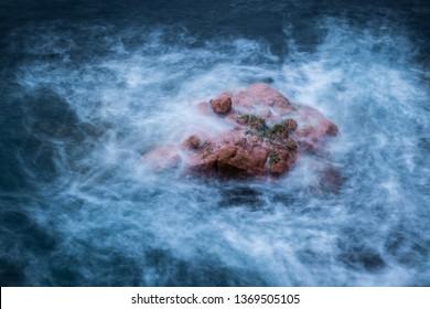 rock in the sea at Freycinet, dawn