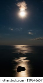 """Rock in the sea in the moonlight. Moonlight path on the water. Rock """"Holy appearance."""""""