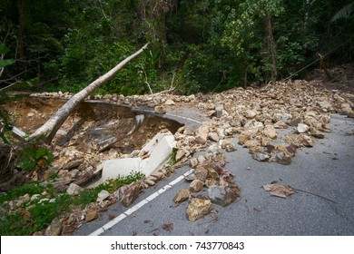 Rock slide collapse after a mudflow on a mountain road in a rural area