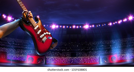 Rock star celebrity on the main stage big music festival. Aroun full stadium of spectators. fans are holding flashlights. first person view