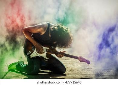 rock star guitarist playing electric guitar