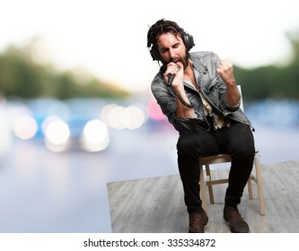 rock star with headphones and microphone