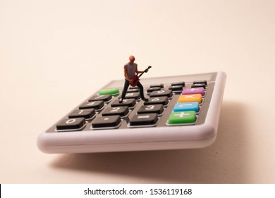 Rock star performing a guitar solo on a calculator. Fun with math, accounting, algebra, taxes and numbers. Crunching numbers can be cool and fun.