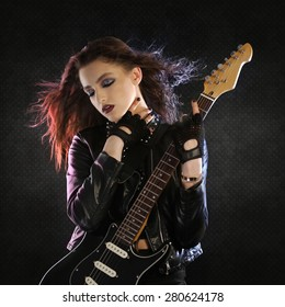 Rock star posing with her guitar