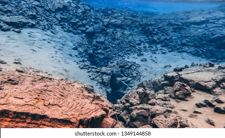 Rock and stones volcanic lava formation underwater in Silfra Thingvettlir national park crack between two tectonic plates Iceland popular touristic fissure drift snorkeling diving recreation activity