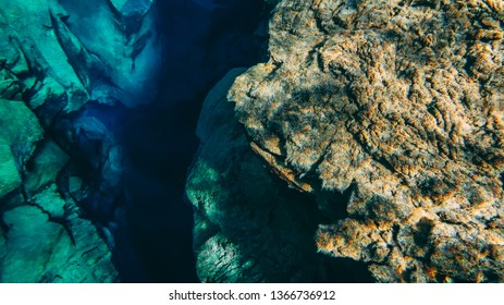 Rock stones volcanic lava formation underwater Silfra Thingvellir national park crack between tectonic plates Iceland popular touristic fissure drift snorkeling diving recreation activity  Pingvellir