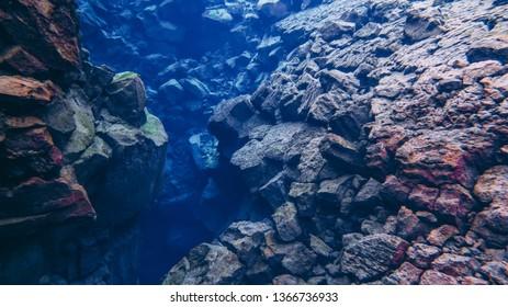 Rock stones volcanic lava formation underwater Silfra Thingvellir national park crack between tectonic plates Iceland popular touristic fissure drift snorkeling diving recreation activity  Pingvellir