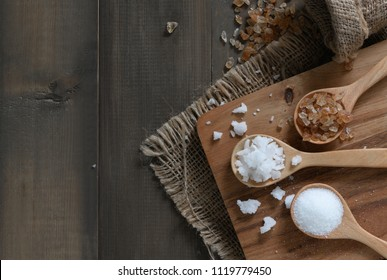 Rock sugar and granulated sugar on wood spoon on old wood background, top view and copy space