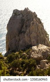 "Rock ""Swan Wing"" on the black sea. Climbers climb the rock. Simeiz. Crimea."