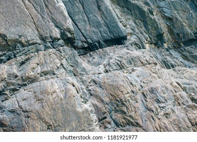 Rock texture background. Closeup of a sedimentary mountain limestone rocks texture.