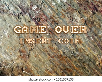 Rock texture background with warm and clear colors. Soft abstract in design with the text GAME OVER, Insert coin, with retro style of the old video games.