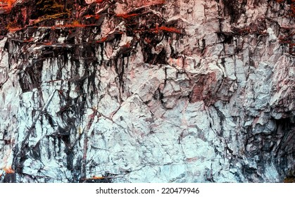 Rock texture with red moss.