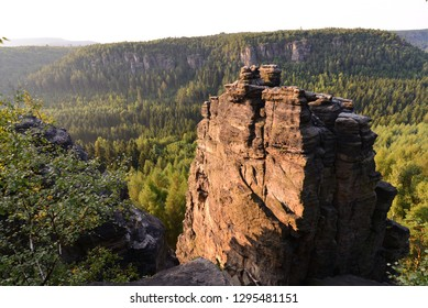 Rock tower in green nature during summer.
