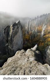 Rock towers inside fog in autumn