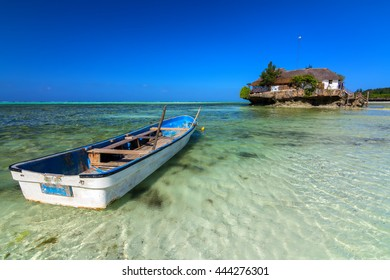 the rock a unique zanzibar island resort along the east coast of the main island with a tender boat in the foreground