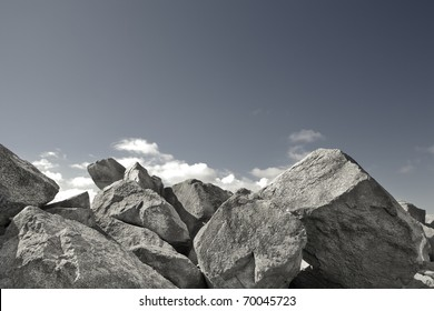 A rock wall against a blue sky.