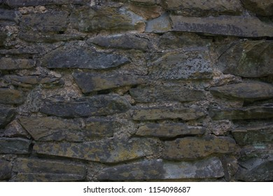 Rock wall background with texture and focus