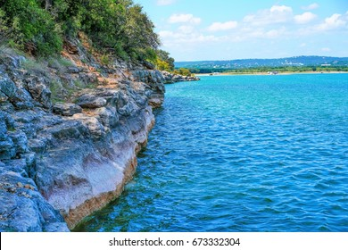 A rock wall coming out of the waters of Lake Travis near Austin Texas.