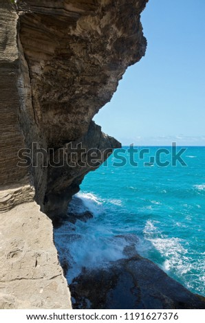 rock wall and ocean along north coast of puerto rico at cueva del indio