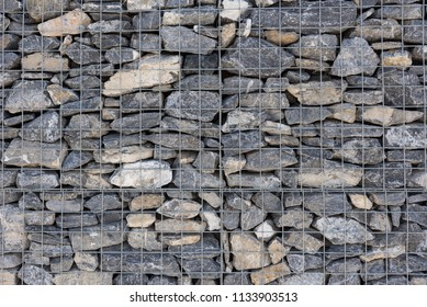 Rock Wall in Rentention Cage background image