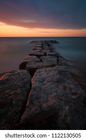 Rock walls of Bright's Grove in Sarnia, Lambton County, Ontario, Canada at sunset in early summer.