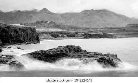 Rock washed by the Atlantic ocean waves, Los Silos, Tenerife, Spain.