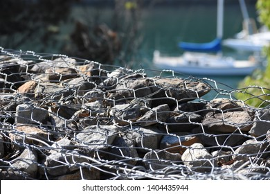 Rock and wire gabion with blur bay background