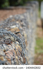 Rock and wire gabion at park