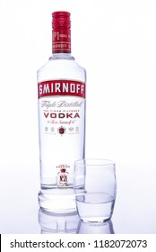 ROCKAWAY, NEW JERSEY - SEPTEMBER 17, 2018: Bottle of Smirnoff vodka with shot glass. In 2006, Diageo North America claimed that Smirnoff vodka was the best-selling distilled spirit brand in the world