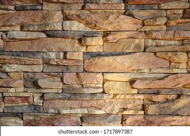 Rocken wall in soft brown colors closeup. Stone and brick wall surface