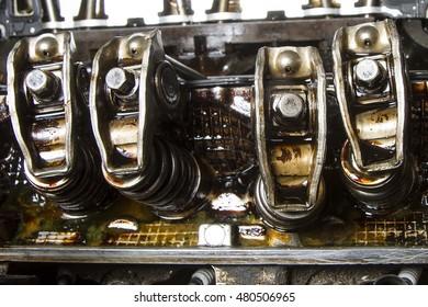 Rocker arms of high mileage engine showing sludge buildup
