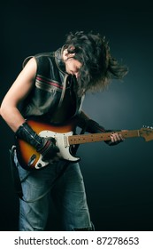 rocker with an electric guitar