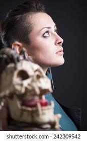 rocker girl with skull on black background