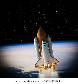 Rocket above earth. The elements of this image furnished by NASA.
