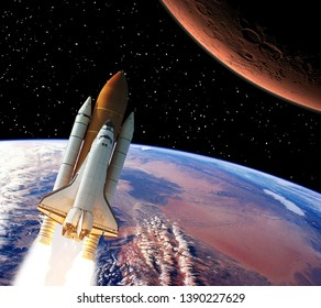 Rocket above earth. Mars in the distance. The elements of this image furnished by NASA.