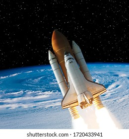 Rocket above the earth. Space concept. The elements of this image furnished by NASA.