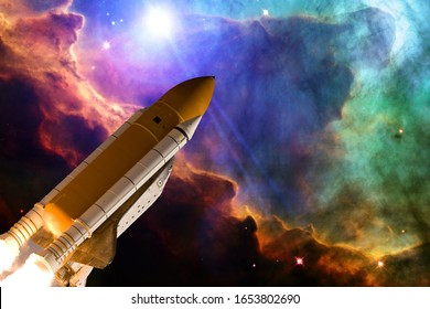 Rocket in the deep space. Galaxy and stars. The elements of this image furnished by NASA.