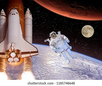 Rocket flies from earth to Mars. Astronaut and moon in the distance. The elements of this image furnished by NASA.