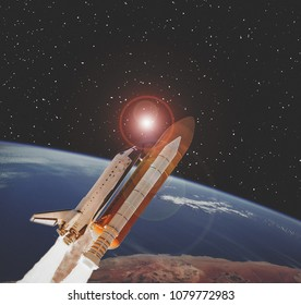 Rocket flying from earth. The elements of this image furnished by NASA.