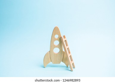 Rocket and ladder on a blue background. The rocket is ready to take off into space. The concept of a startup, education and the desire to research. Space tourism, flight to the moon or mars